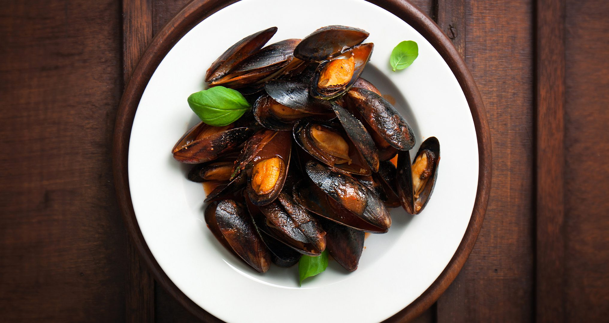Freshly cooked mussels with a tomato wine sauce